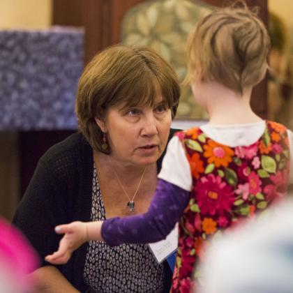 A young book lover shares a story with author Lori Degman.