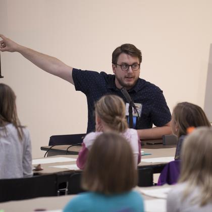 Illustrator Mike Lowery points out his technique during a drawing workshop.